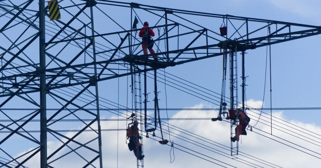 workers carrying out maintenance on an electricity pylon