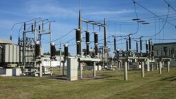 Electricity distribution sub station grass and blue skies