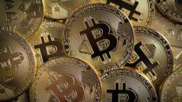 a pile of gold bitcoin