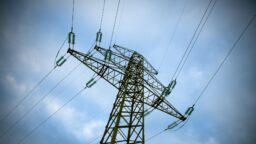 ergon demand based tariff electricity pylon against a blue sky